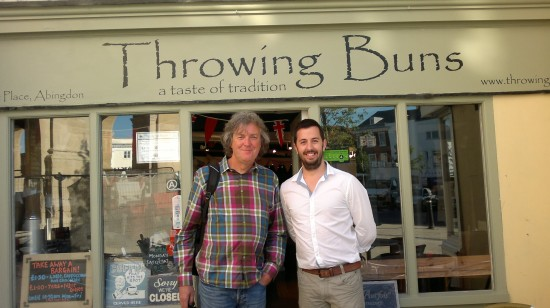 photo of james may and phil in front of throwing buns